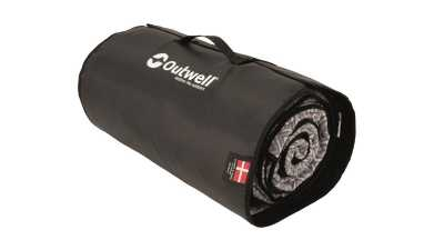 Flat-woven carpet packed in its carry bag